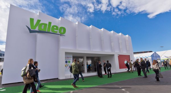 A Valeo studio at Consumer Electronics Show 2017 in Las Vegas with attendees walking down the street next to the studio