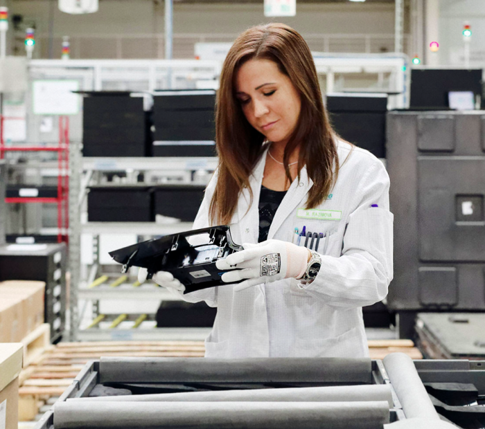 Woman inspecting a Valeo product