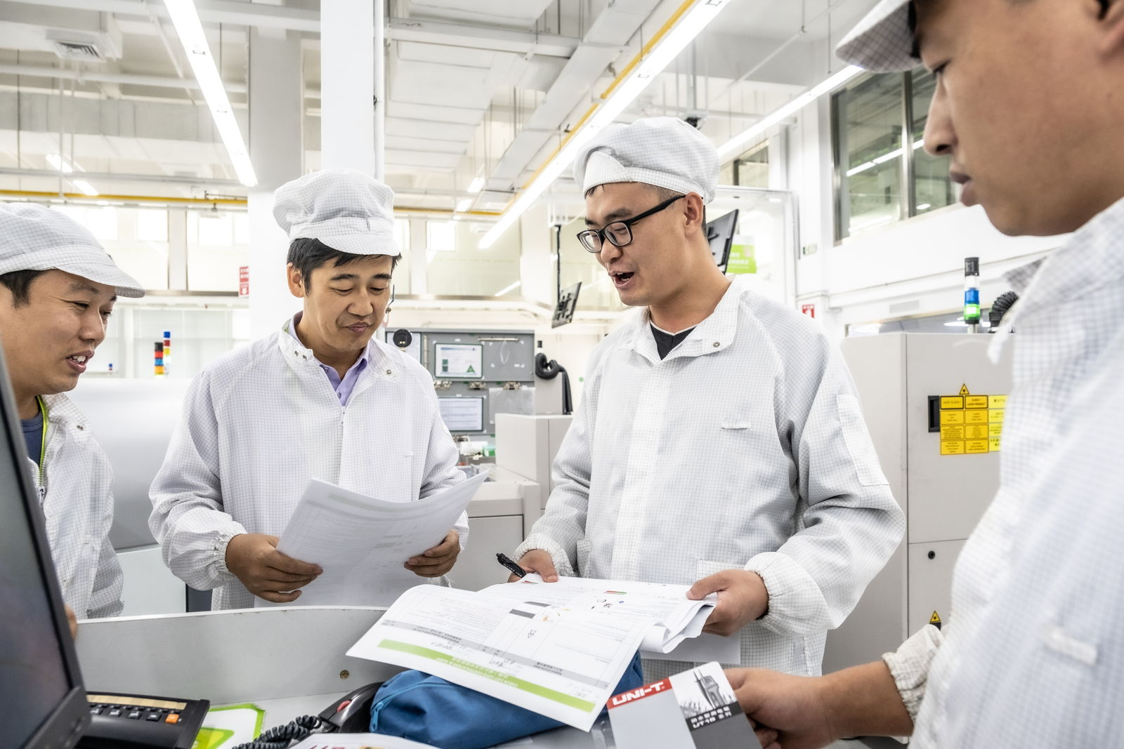 4 men in a meeting in China plant