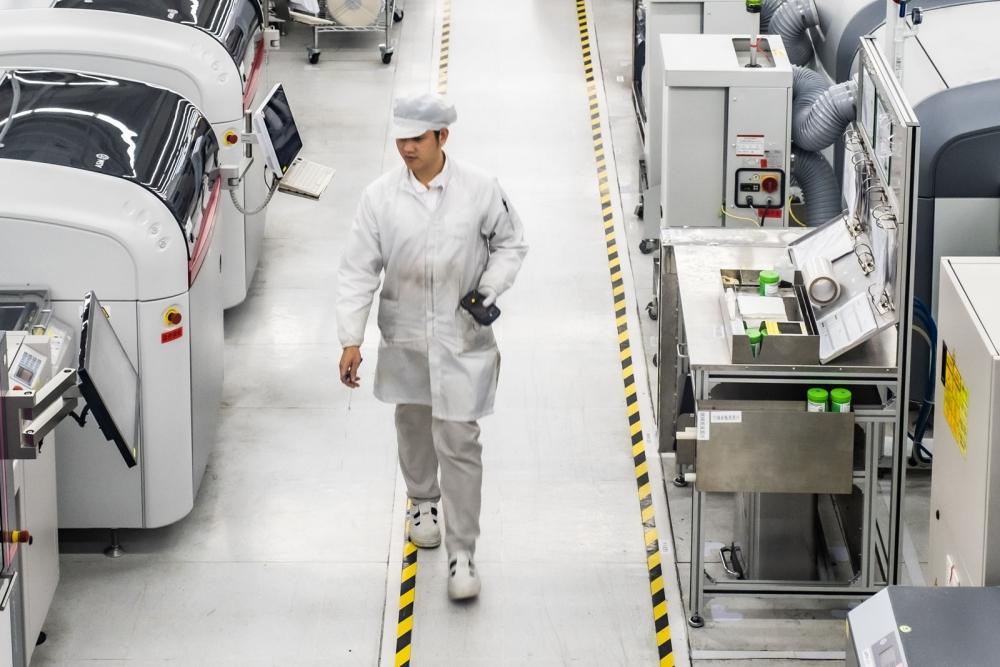 valeo employee walking in China plant