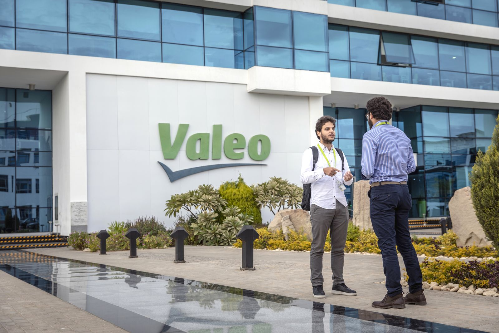 two Valeo workers outside of Egypt plant in Cairo