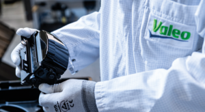Valeo worker inspecting a product