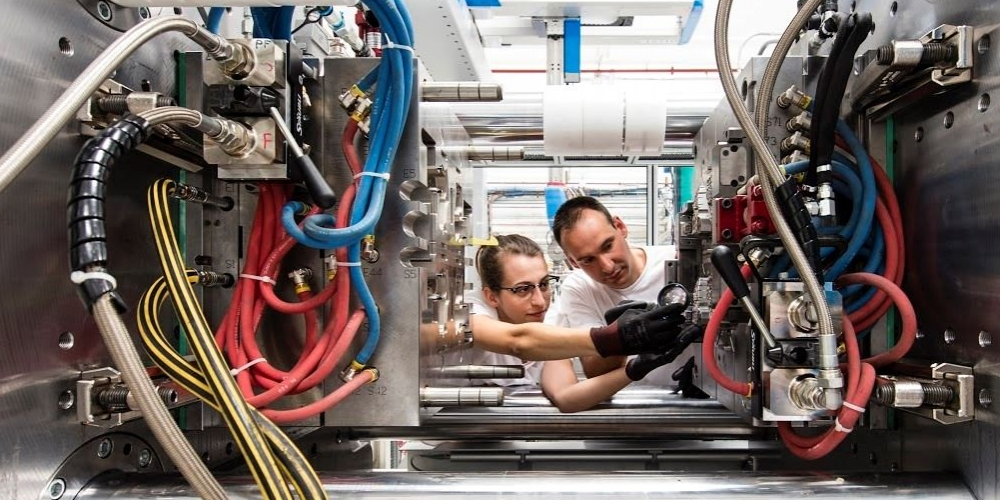 Two workers doing maintenance work at Valeo Germany